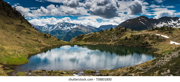 Wide panoramic vista over Tristaina lake in Pyrenees,Andorra