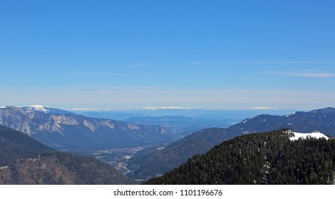 wide panormaric view of moutains from Italy to Austria. In the valley there is the small town of Tarvisio in Northern Italy