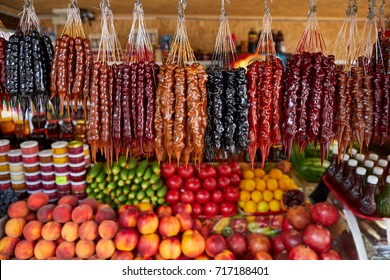 Wide range of Colorful Georgian traditional homemade sausage-shaped churchkhela candy on sale in small street market shop in Adler town.