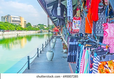 The wide range of stalls, offering clothes, shoes, souvenirs and other goods in Pettah Floating Market, Colombo, Sri Lanka.