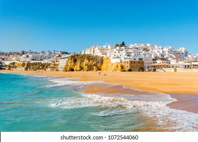 Wide sandy beach in white city of Albufeira, Algarve, Portugal