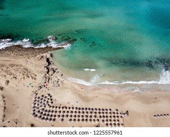 Wide sandy coastline, long sea waves of Falasarna beach Crete, Greece