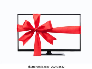 wide screen tv monitor tied with red ribbon isolated on white