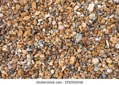 A wide selection of various pebbles of different shapes, sizes and colours on Seasalter beach near Whitstable in Kent.