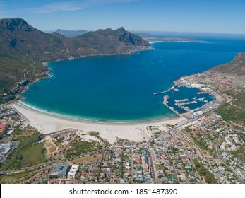 Wide shot of the aerial view of the coast of Hout Bay in Cape Town, South Africa.