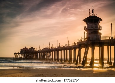A wide shot of the Huntington Beach Pier  during sunset on a cool winter day.