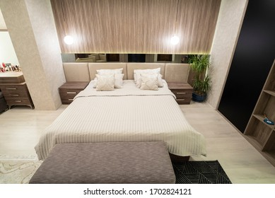 wide shot of an interior of a master bedroom with table lamp in amman jordan 12-2-2019