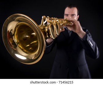 wide shot of male musician playing strait soprano saxophone
