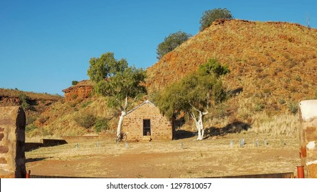 wide shot of an old hut and ghost gums at the overland telegraph station, barrow creek in australia's northern territory