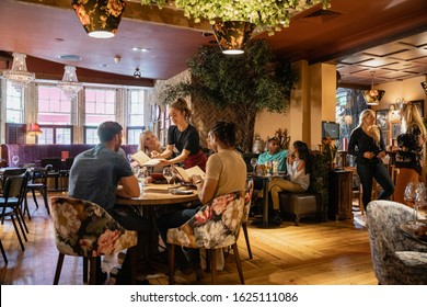 A wide shot of people dining at a restaurant in Newcastle-upon-Tyne.