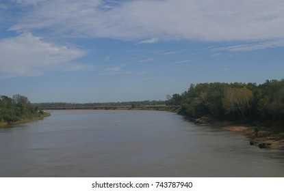 Wide shot of the Red River at the border of Oklahoma and Texas along Interstate 35. The Red River is the second largest river basin in the Great Plains forking to the Texas Panhandle and Oklahoma.