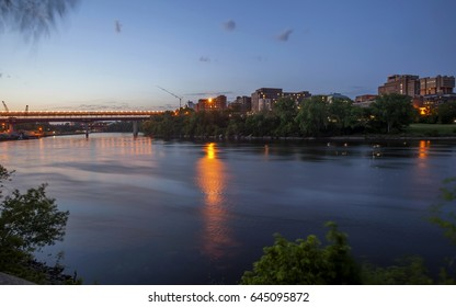 A Wide Shot of the Washington Avenue Bridge over the Mississippi River and University of Minnesota College Campus at Twilight