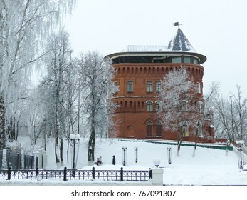 Wide shot winter snowy landscape red brick building snow