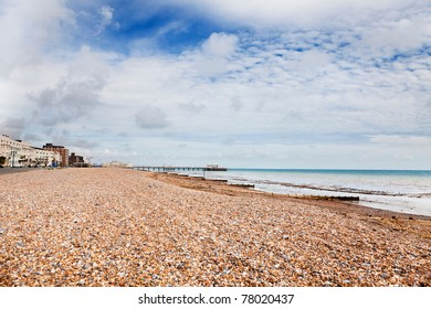Wide shot of Worthing beach at low tide, with the Victorian pier in the distance