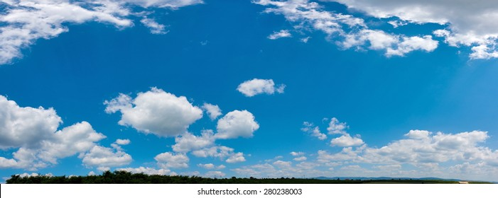 Wide sky panorama with scattered cumulus clouds