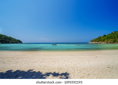 Wide tropical beach and sea