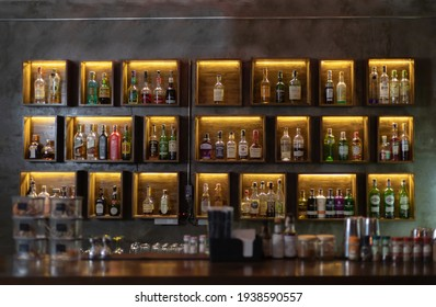 Wide variety of bottles of alcohol or liqueur are placed on the shelves of a vintage bar in Chiangmai, THAILAND: March 4, 2021