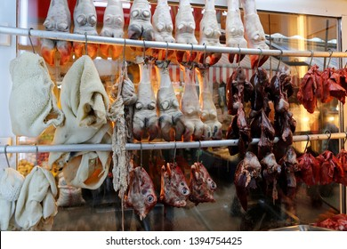 Wide variety of raw offals in a butcher shop