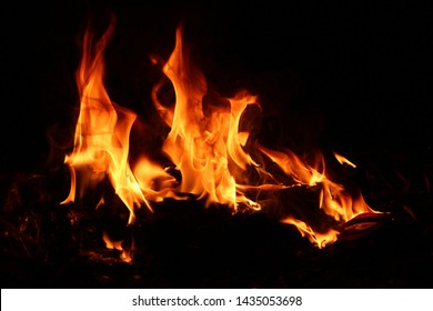 A wide variety of red flames that burned, fluttering naturally in the dark at night.