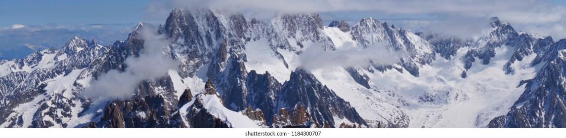 Wide view of alpine Alps in Switzerland in summer