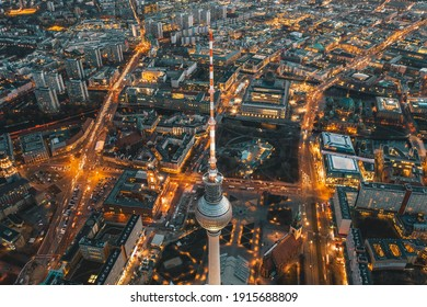 Wide View of Beautiful Berlin, Germany Cityscape after Sunset with lit up Streets and Alexanderplatz TV Tower, Aerial Drone View circa September 2019