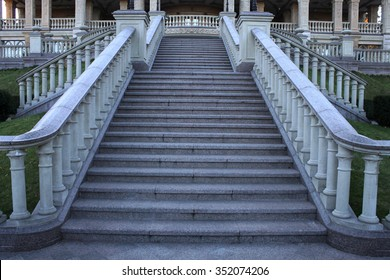 wide view with beautiful classical mansion staircase with balustrade in the park