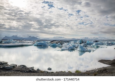 Wide view of blue icebergs floating in Jokulsarlon glacial lagoon, Iceland