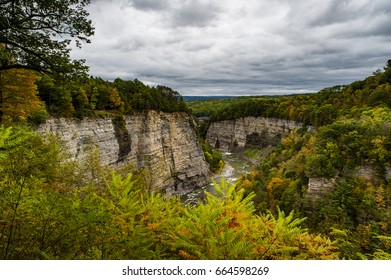 A wide view of a canyon on a cloudy, overcast afternoon in Letchworth State Park in the Finger Lakes region of New York.