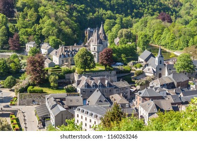 Wide view to city from above. Green trees and medieval buildings in town. Durbuy, Belgium