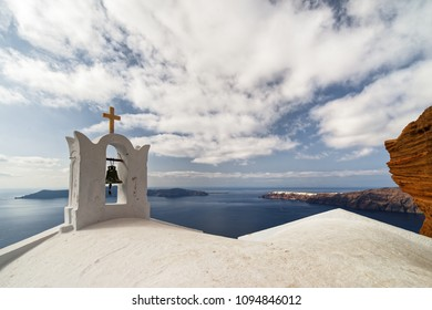 Wide view from the crater rim over the roof of a typical church to the opposite islands - Location: Greece, Cyclades, Santorini (Santorin, Thira)
