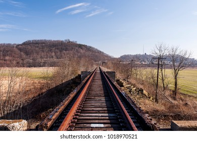 A wide view of derelict, unused tracks along the Norfolk Western Railway Portsmouth Subdivision in the Appalachian Mountains near Portsmouth, Ohio.