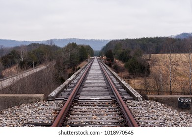 A wide view of derelict, unused tracks along the Norfolk Western Railway Portsmouth Subdivision in the Appalachian Mountains near Peebles, Ohio.