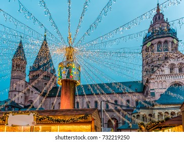 Wide view of the Mainz christmas tower with strings of christmas lights and the church in the background