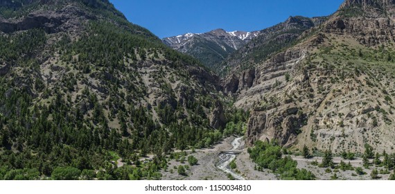 Wide view of massive mountain canyons in the western wilderness of Wyoming.