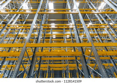Wide view metalic scaffolding with yellow bars inside the building