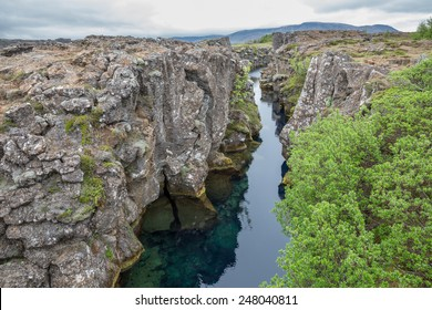 Wide view of National Park of Thingvellir with stream and rocks in Iceland