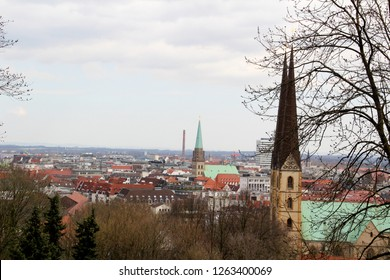 wide view on the built structure and church steeples in bielefeld germany photographed during a sightseeing tour at a sunny day