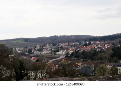 wide view on the built structure and the hill at the horizon from the sparrenburg in bielefeld germany photographed during a sightseeing tour at a sunny day