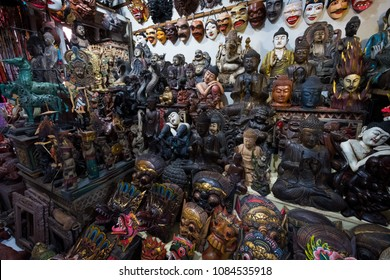 Wide view of small handcrafted statues in a souvenir shop at the market in Ubud, Bali, Indonesia