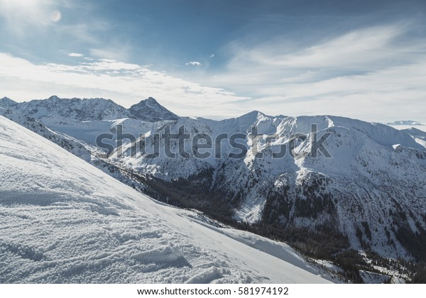 Wide view of the snowy peaks of the Tatry mountains on the border of Poland and Slovakia