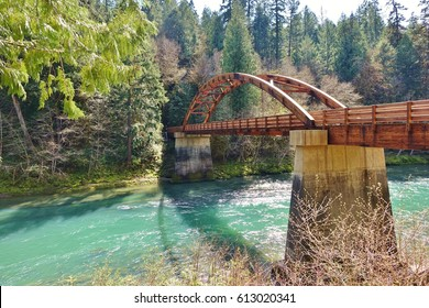 Wide view of Tioga Bridge over North Umpqua River, built in 2014 on concrete piers left from a bridge washed out  by 1964 flood. Bridge near Roseburg, Oregon gives new access  to popular hiking trail.