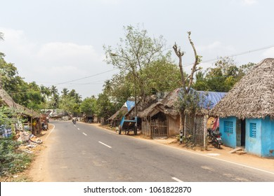 Wide view of unidentified vintage hut houses in south india
