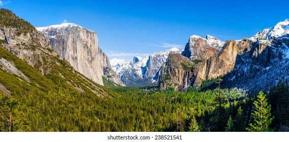 Wide view of Yosemite Valley and Bridalveil Falls in Yosemite National Park, California
