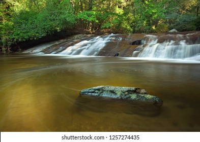 Wide waterfall in lush forest and spiral current, in North Carolina
