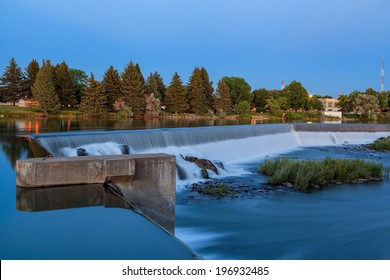 Wide waterfall on Snake River, in Idaho Falls, Idaho.  Near dusk of Summer time. Part of Power HydroElectric project of the city.