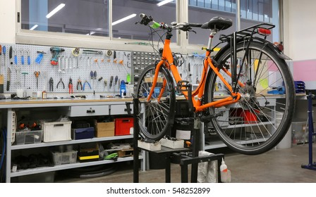 wide and well-equipped workshop for repairing bicycles