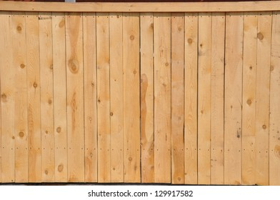A wide wooden fence.