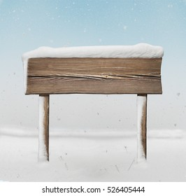 Wide wooden signpost with less snow on it and snowfall on background