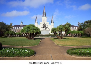 Wide-angle color DSLR picture of St. Louis Cathedral, Jackson Square, New Orleans, Louisiana with statue of President Andrew Jackson. Popular tourist destination.  Horizontal with copy space for text