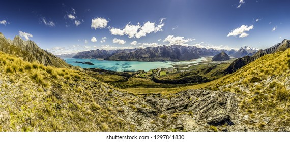 Wideangle panorama shot of Lake Wakatipu and Glenorchy mountains in New Zealand. Scenic view of famous location from Lord of the Rings movie trilogy. 360 degrees aerial lookout. NZ nature landscape.